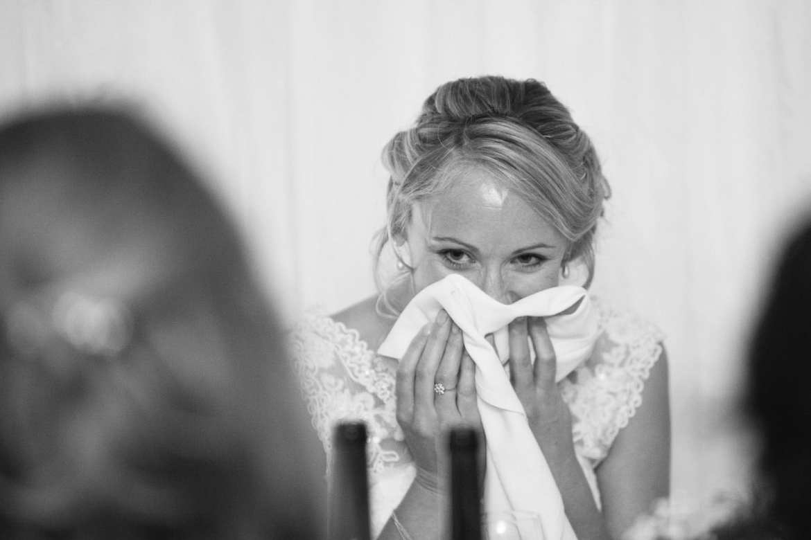Black & white image of bride during speeches
