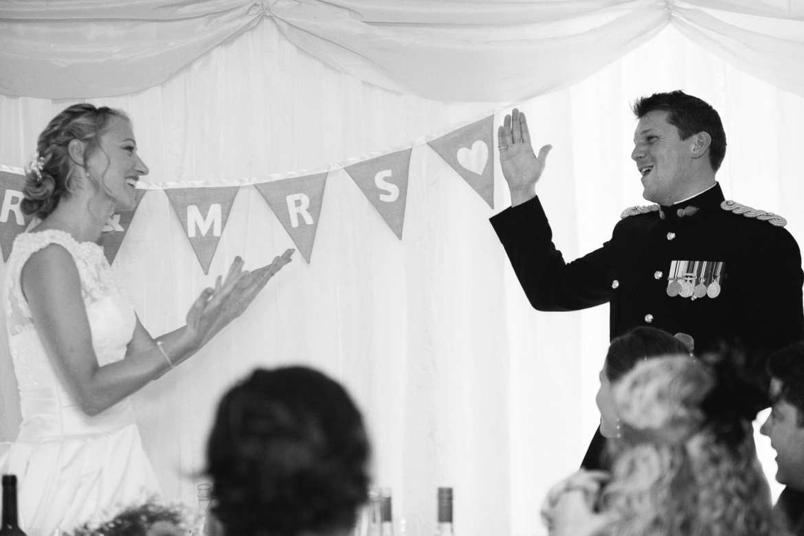 Black & white image of couple standing during speeches