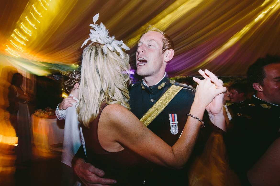 One of the military honour guard dancing with his wife