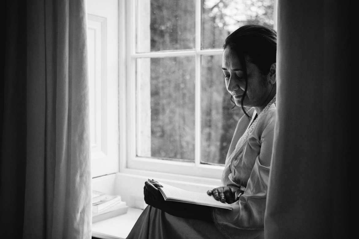 Black and White image of Mother of the Bride reading a book