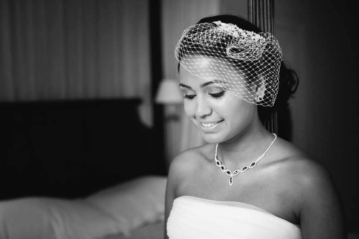 A black and white portrait of the bride