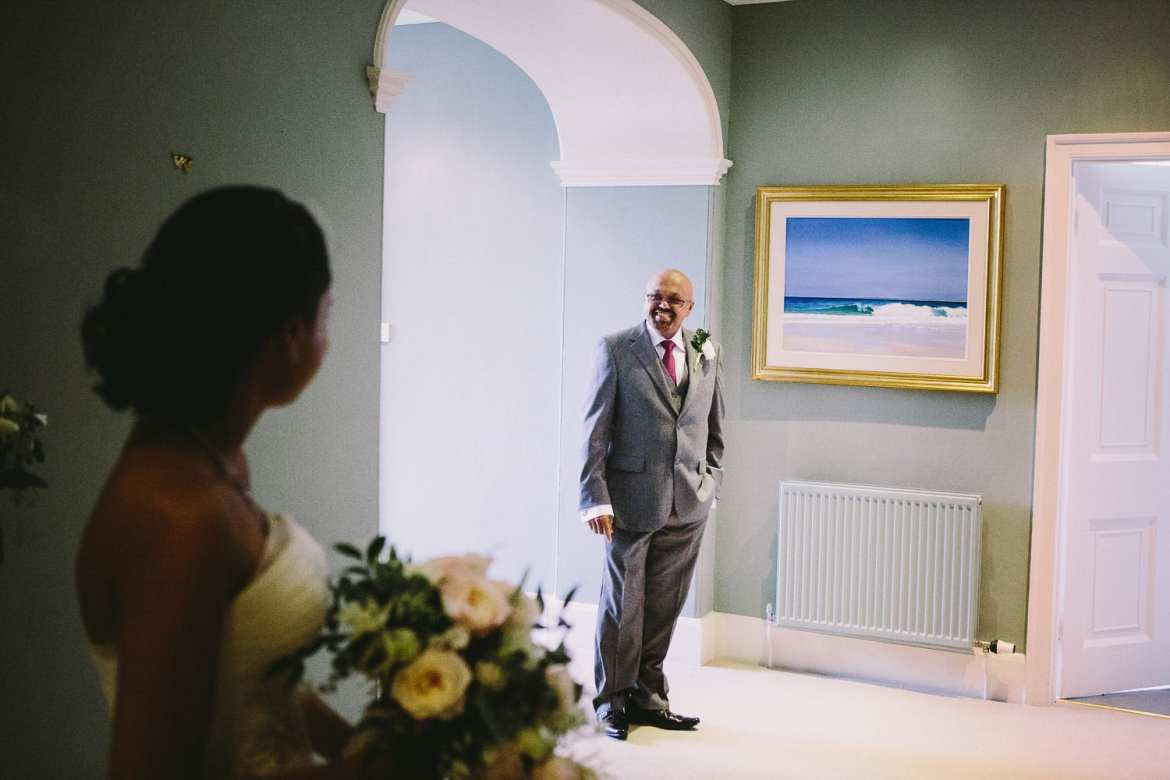 The bride's father sees his daughter for the first time