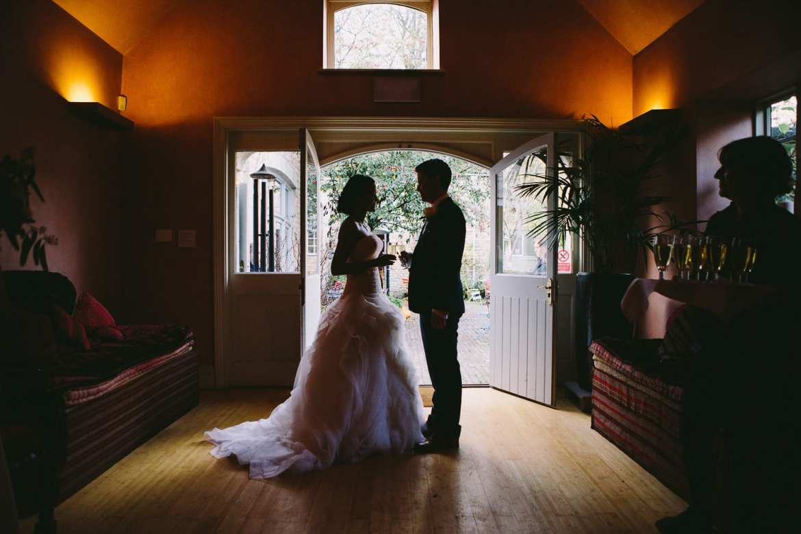 A silhouette of the bride and groom after the ceremony