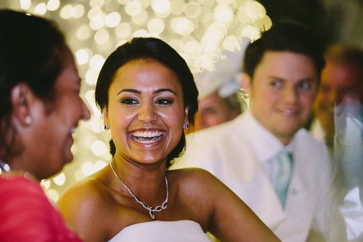 The bride laughing with her mum