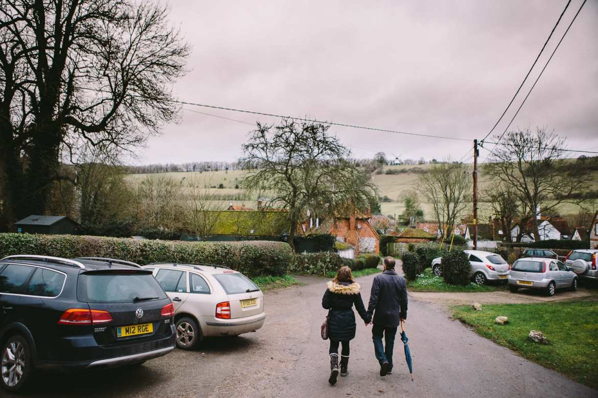 A couple walk into Turville village
