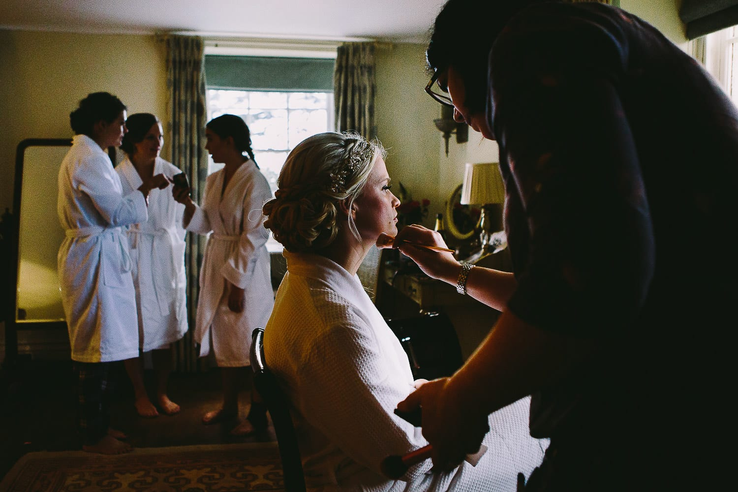 bride having her makeup applied