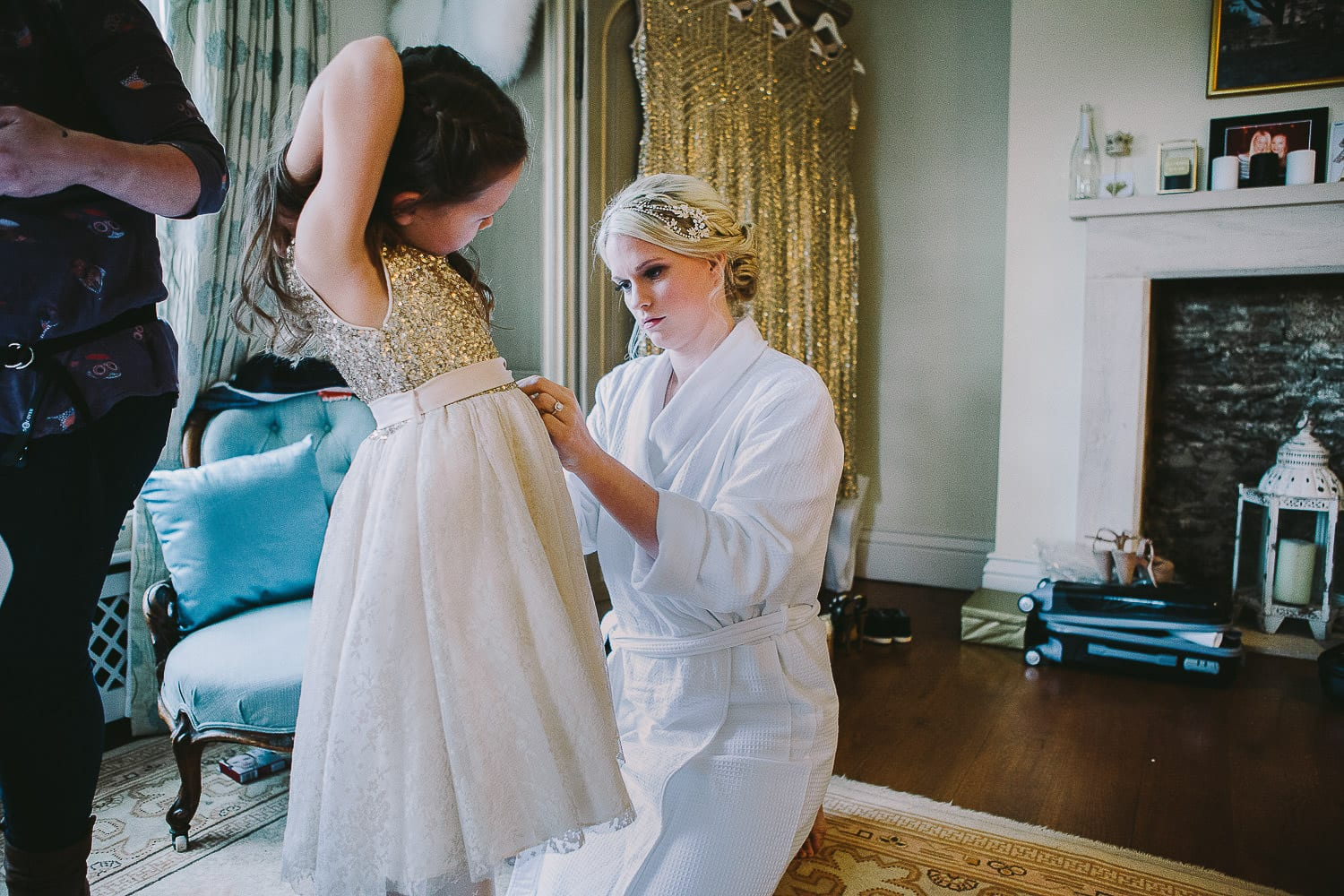bride dressing the flower girl