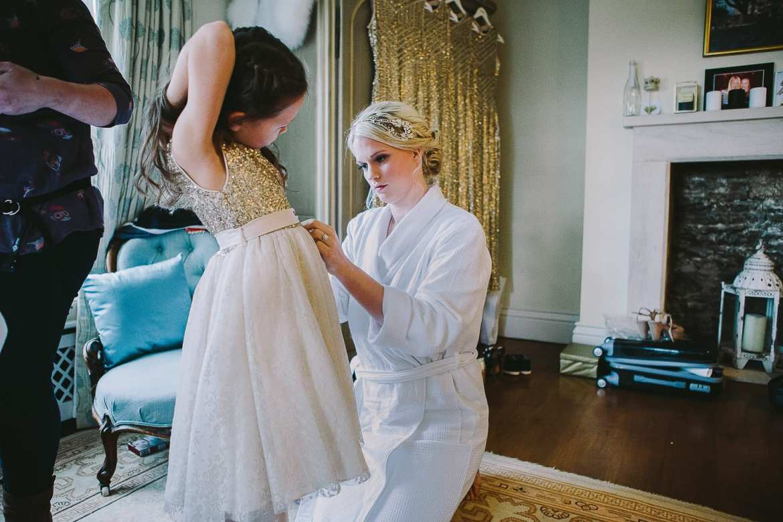 bride dressing the flower girl
