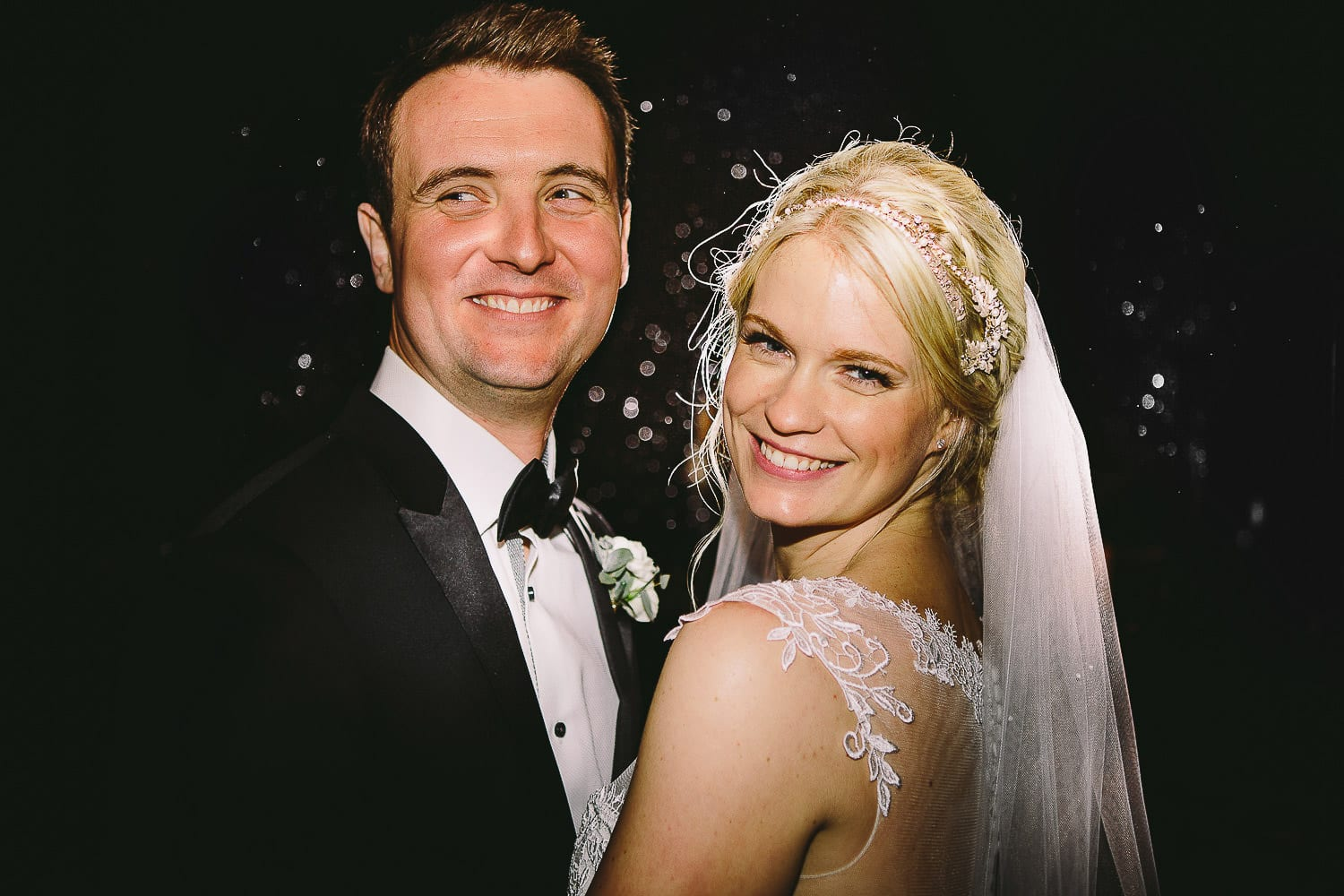 Close up image of the bride and groom in a doorway
