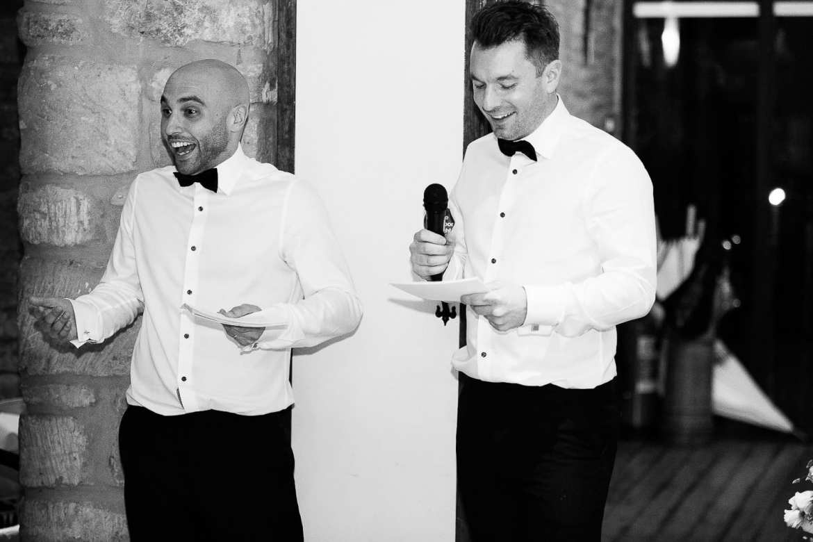 Black and white image of best men doing their speech