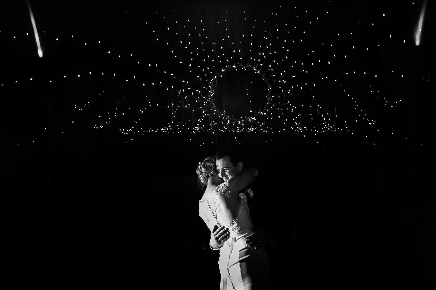 Black and white image of the bride and grooms first dance