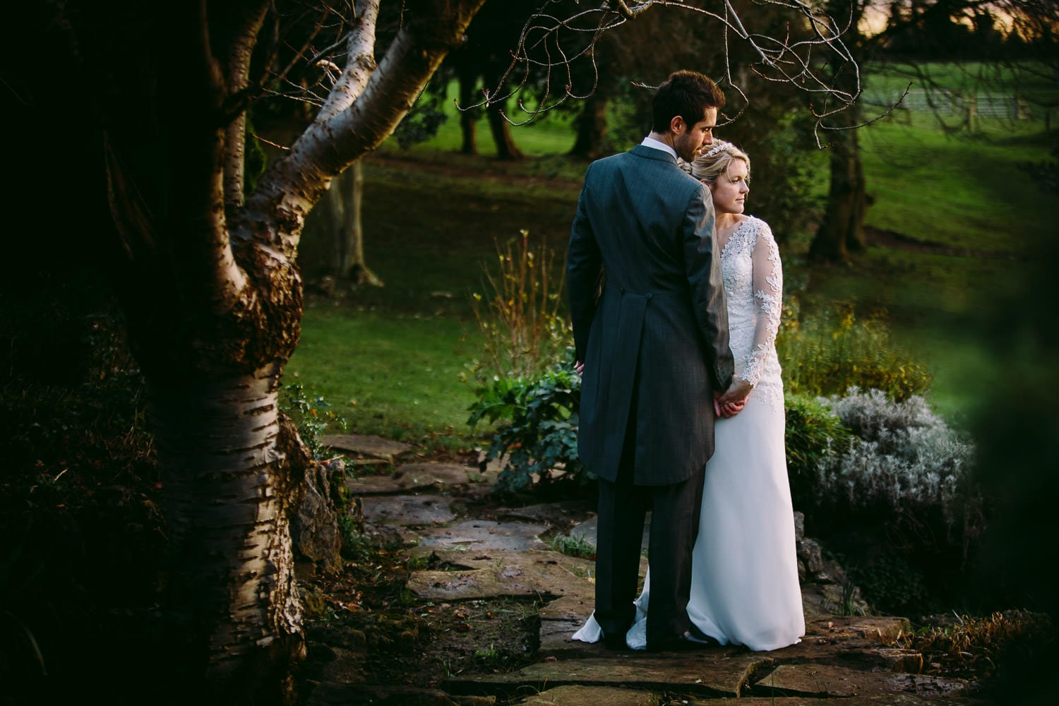 A portrait of the bride and groom in the garden