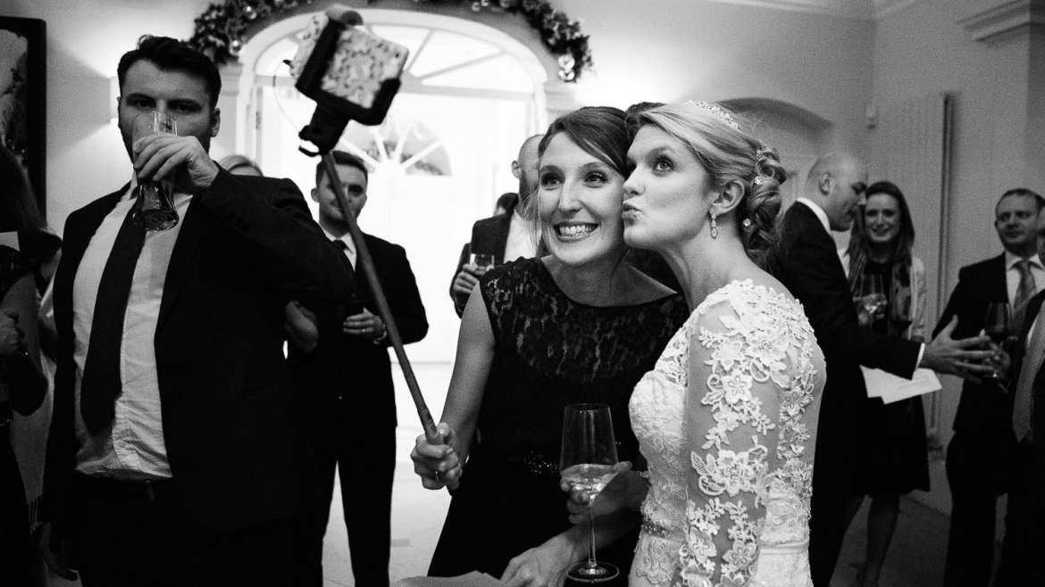 The bride and a bridesmaid taking a selfie