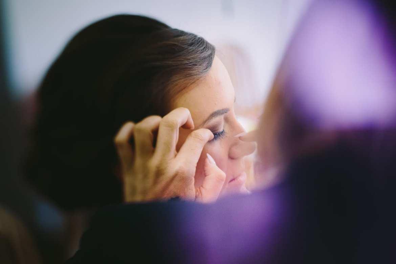Katy Pheiffer applies a bride's eyelashes