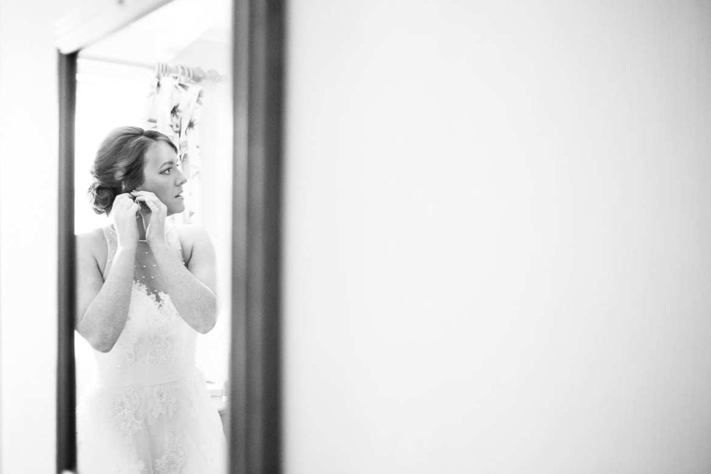 The bride puts her earrings in