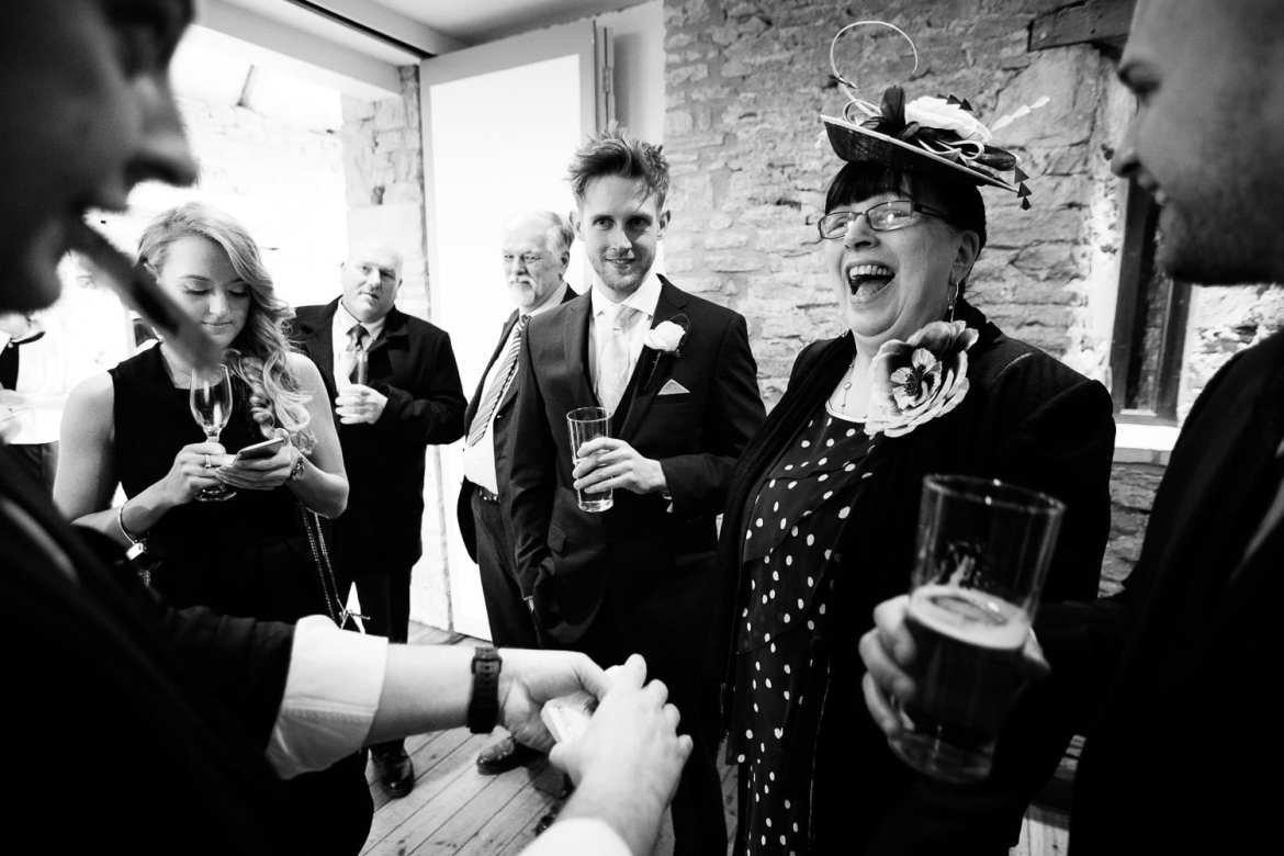 A surprised guest looks delighted as the magician reveals her card