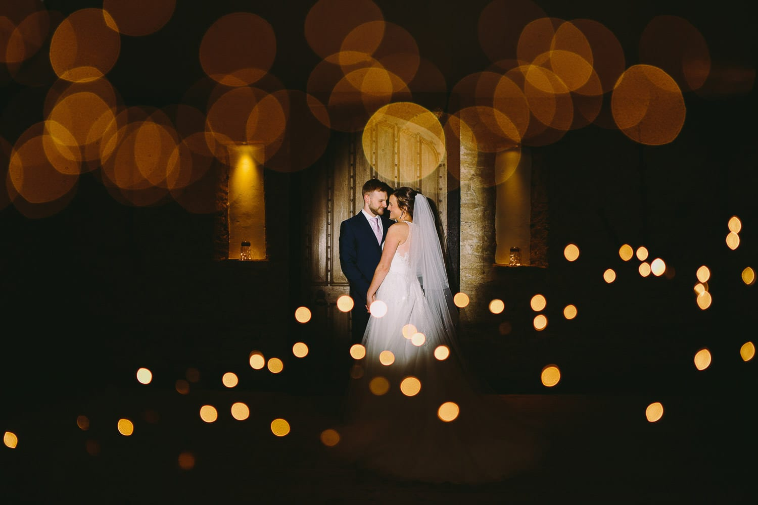 Portrait of a bride and groom indoors at the great tythe barn