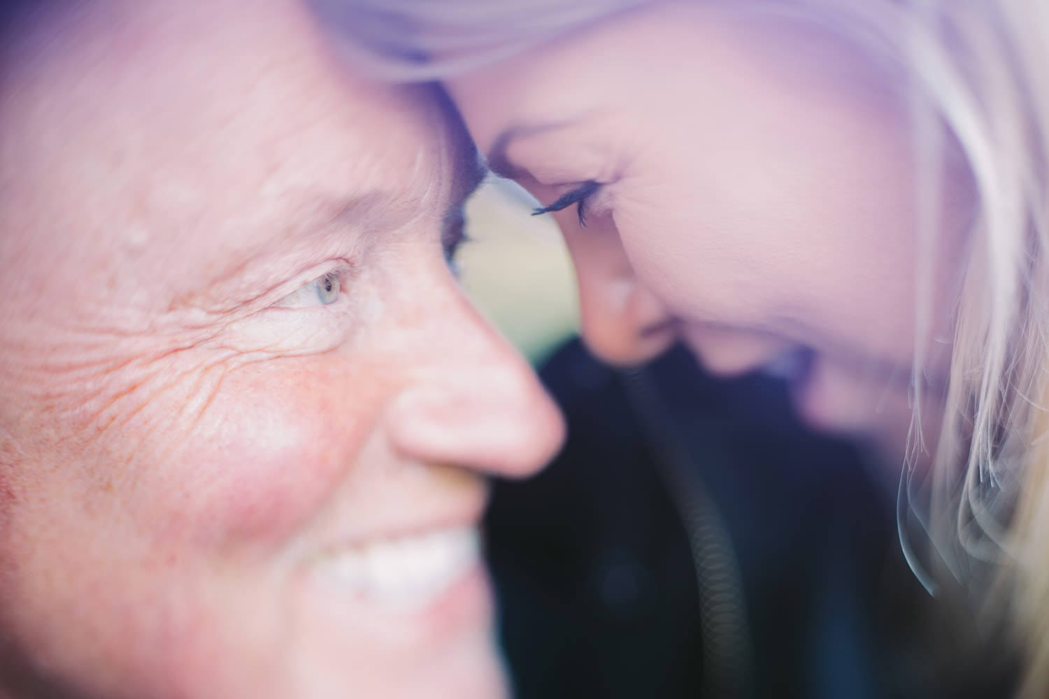 Close up of engaged couple with their heads together freelensing