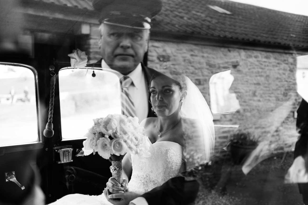 The bride arrives with her dad for her Kingscote Barn wedding