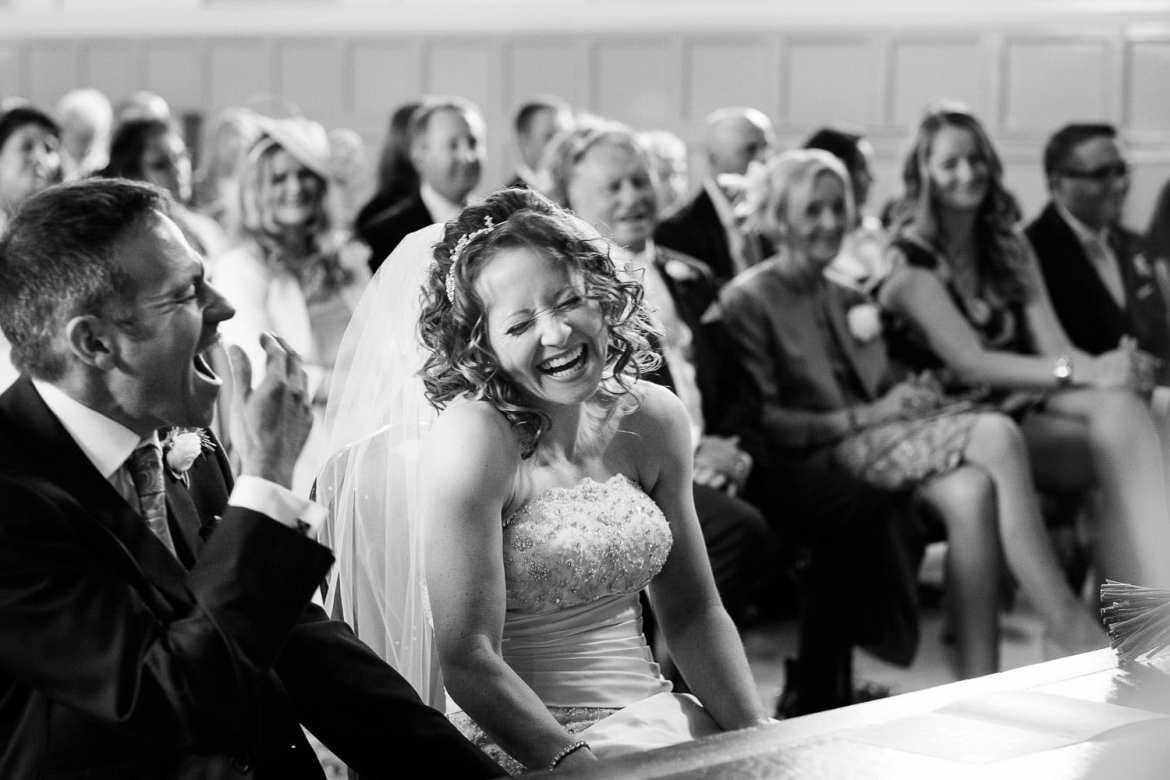 Bride and groom laughing during ceremony at Henley Town Hall