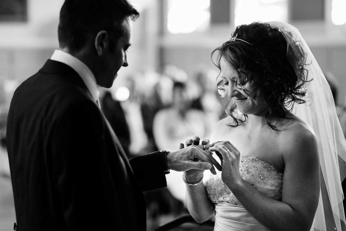 Exchange of rings during wedding at Henley Town Hall