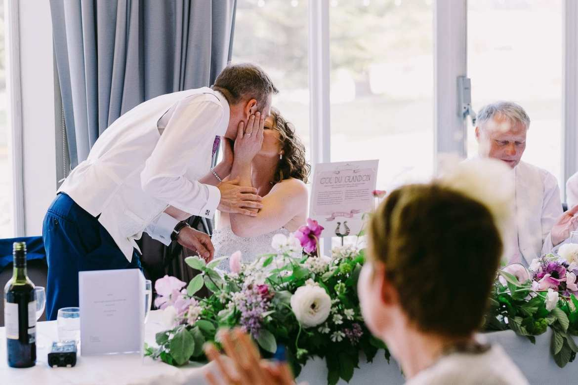 Groom kisses his bride after his speech at Greenlands
