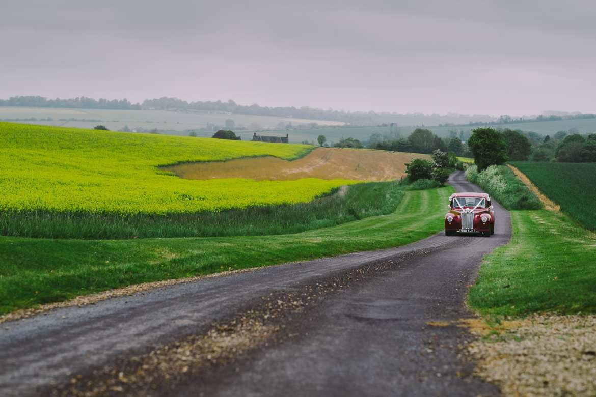 The wedding car coming up the drive at Wellington Barn