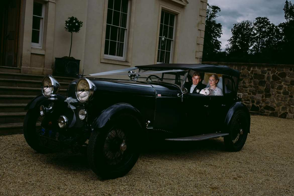The newlyweds in the wedding car arrive at Rockley Manor