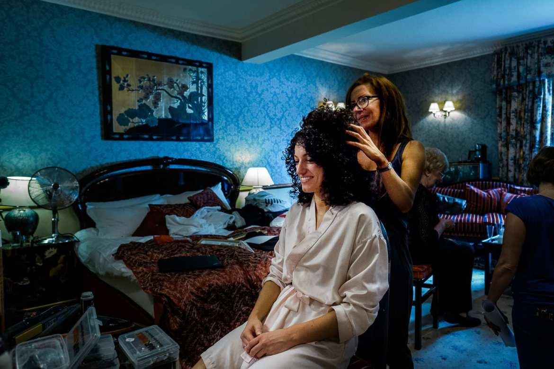The bride having her wedding hair done