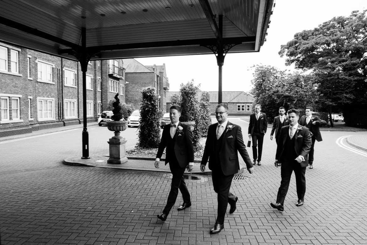The groom and ushers arrive at the pub