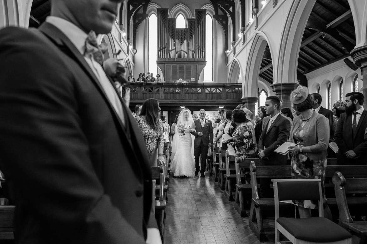 Claire and her father walk down the aisle