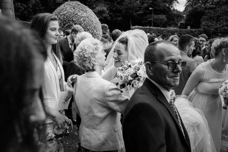 The bride hugs her grandmother
