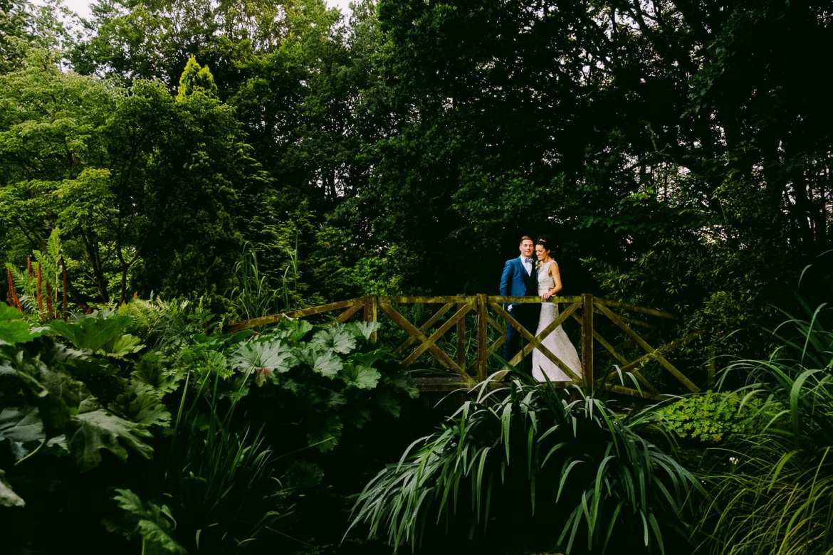 The bride and groom on the bridge