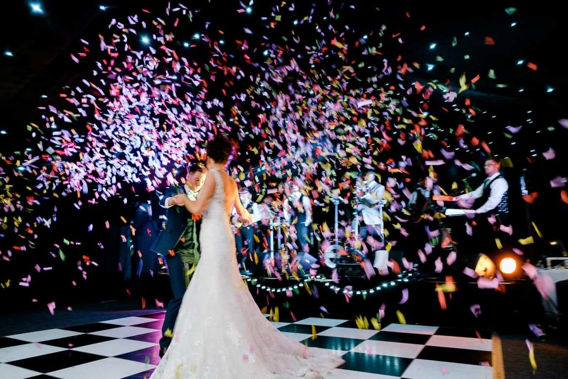Confetti canons fire during the first dance