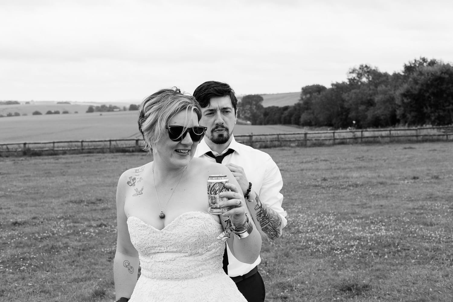 The bride and groom in a field