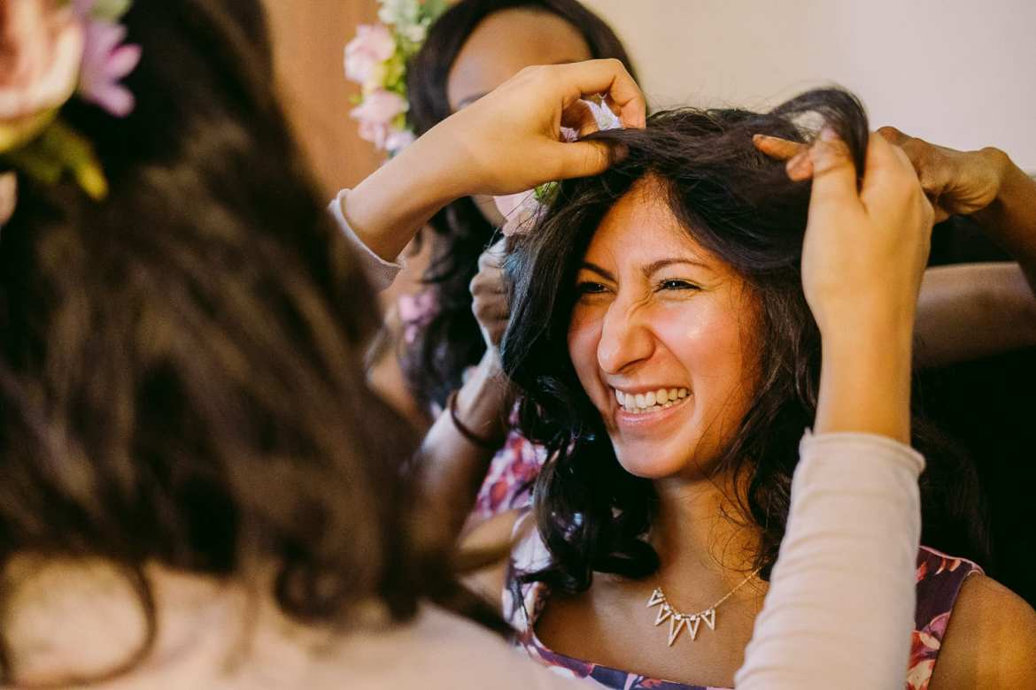 Bride's sister laughing