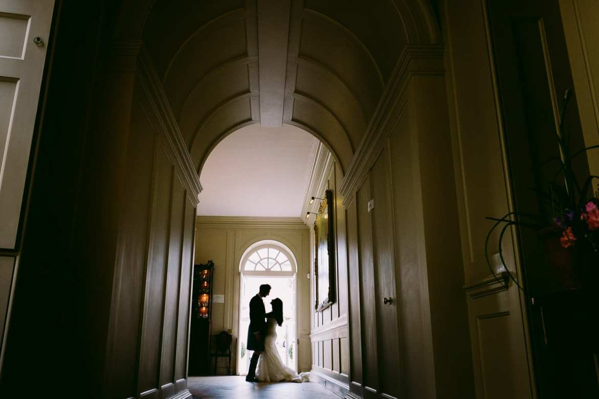 The bride and groom silhouetted in the doorway