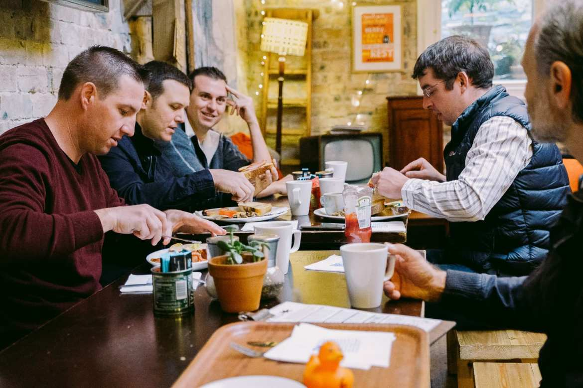 The groom and groomsmen eat breakfast