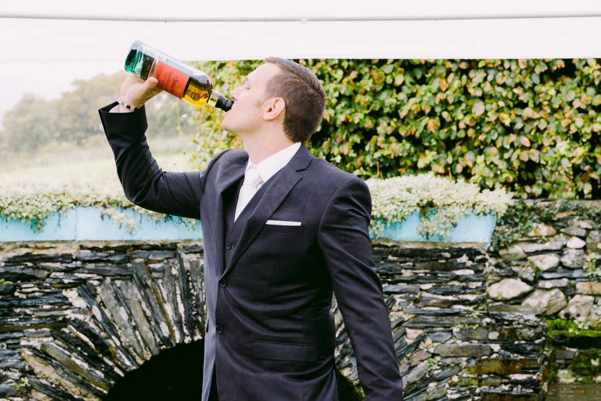The groom having a drink before the ceremony
