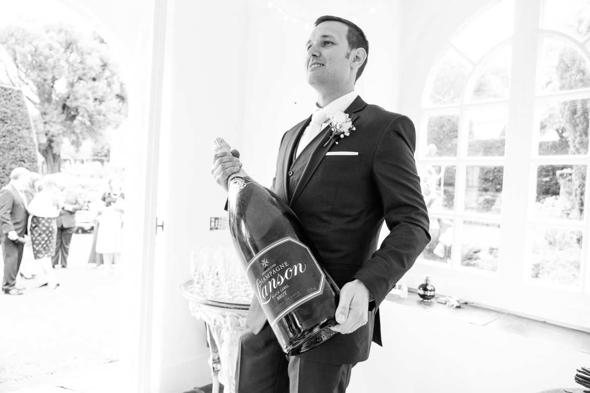 The groom holding a large Lanson Salmanazar
