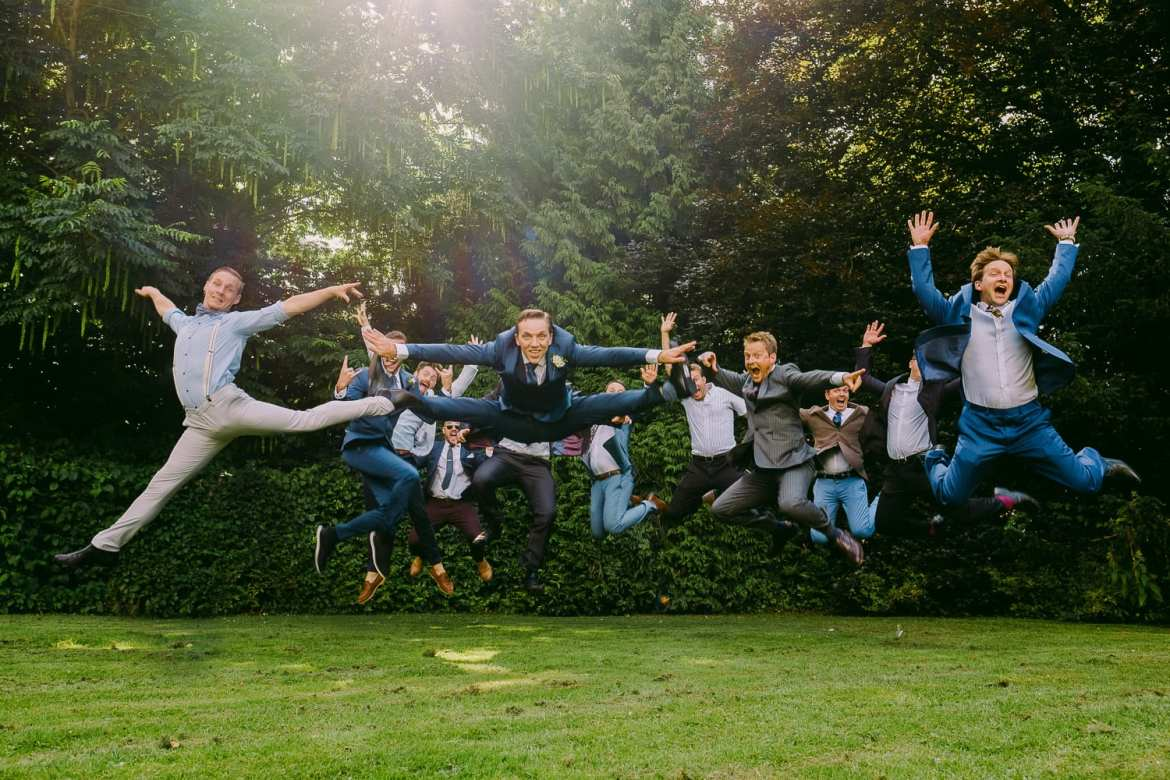 The groom and ushers perform the jump shot