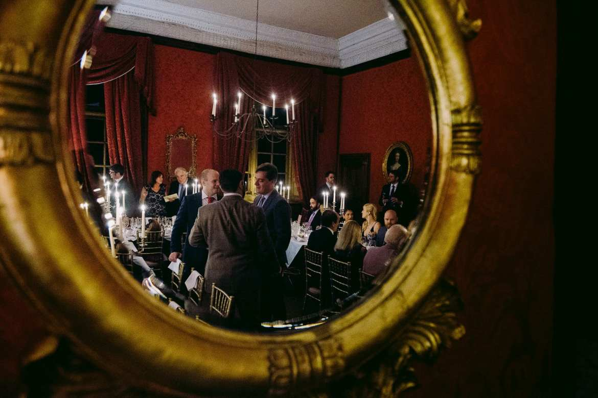 The wedding guests reflected in the mirror