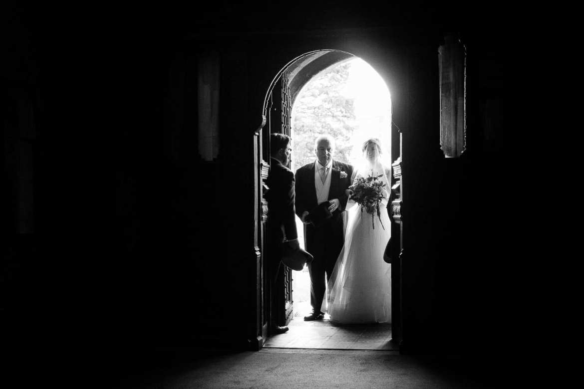 The bride and her father in the church doorway