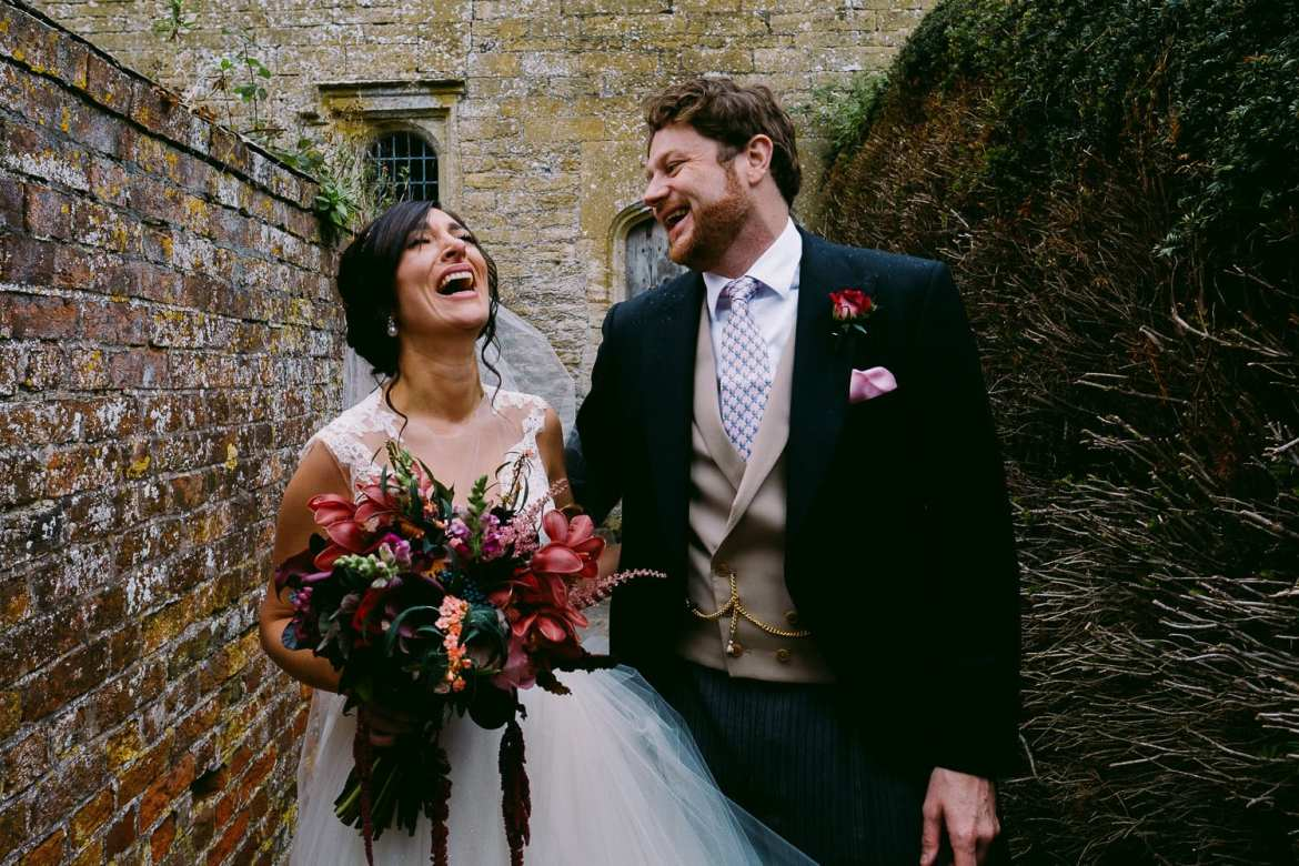 The bride and groom laughing at their Brympton House wedding