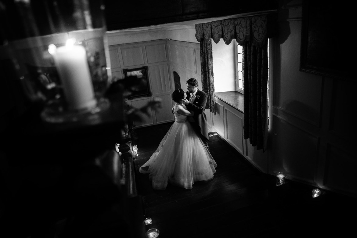bride and groom on the stairs at Brympton House