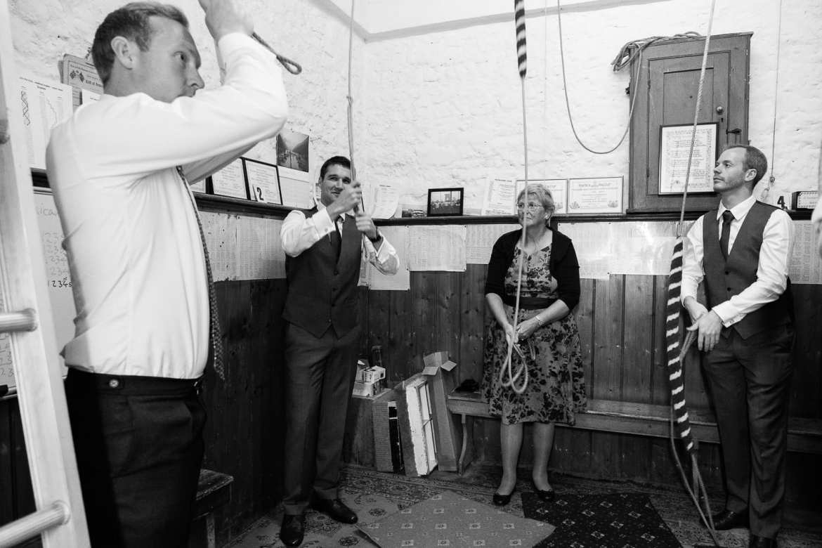 The groom ringing the church bells