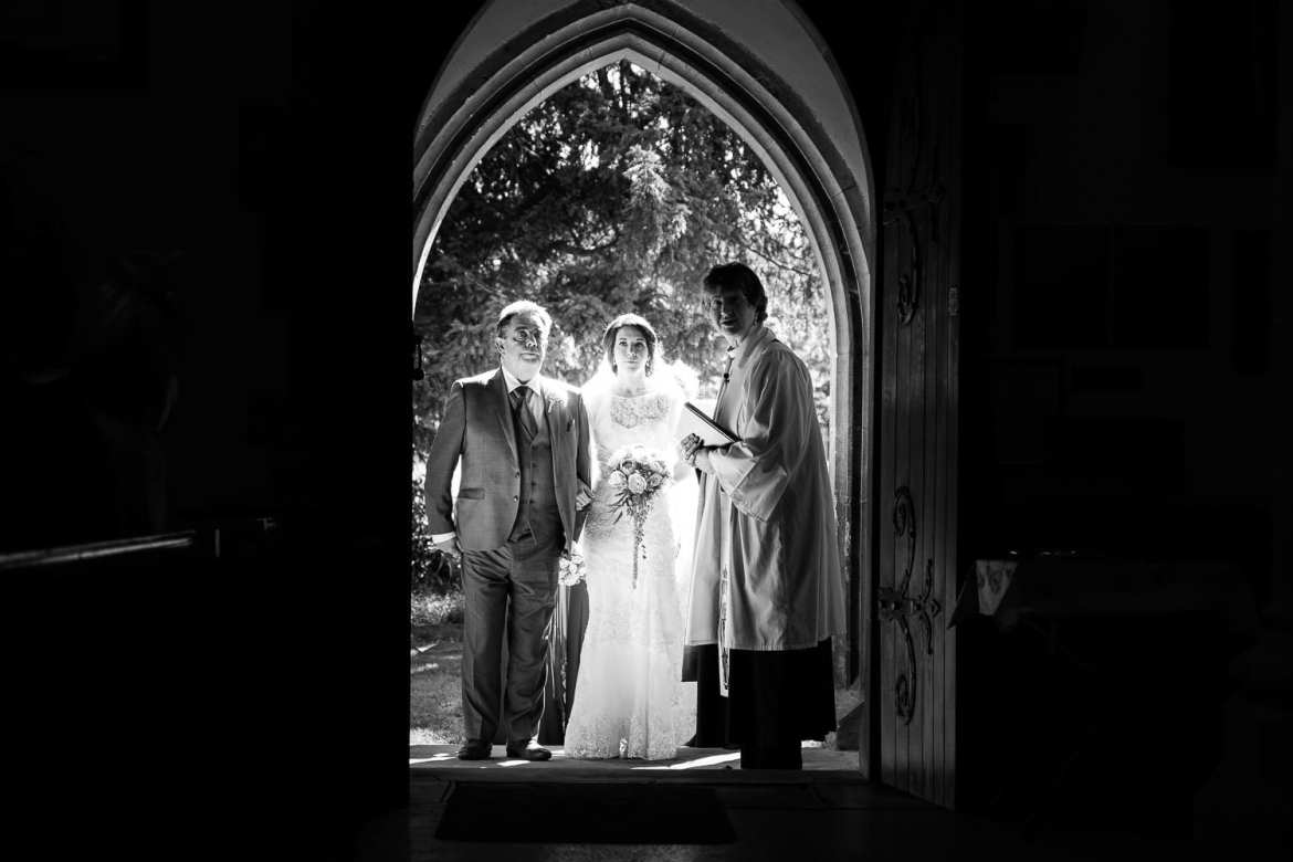 The bride and her father on the steps of the church