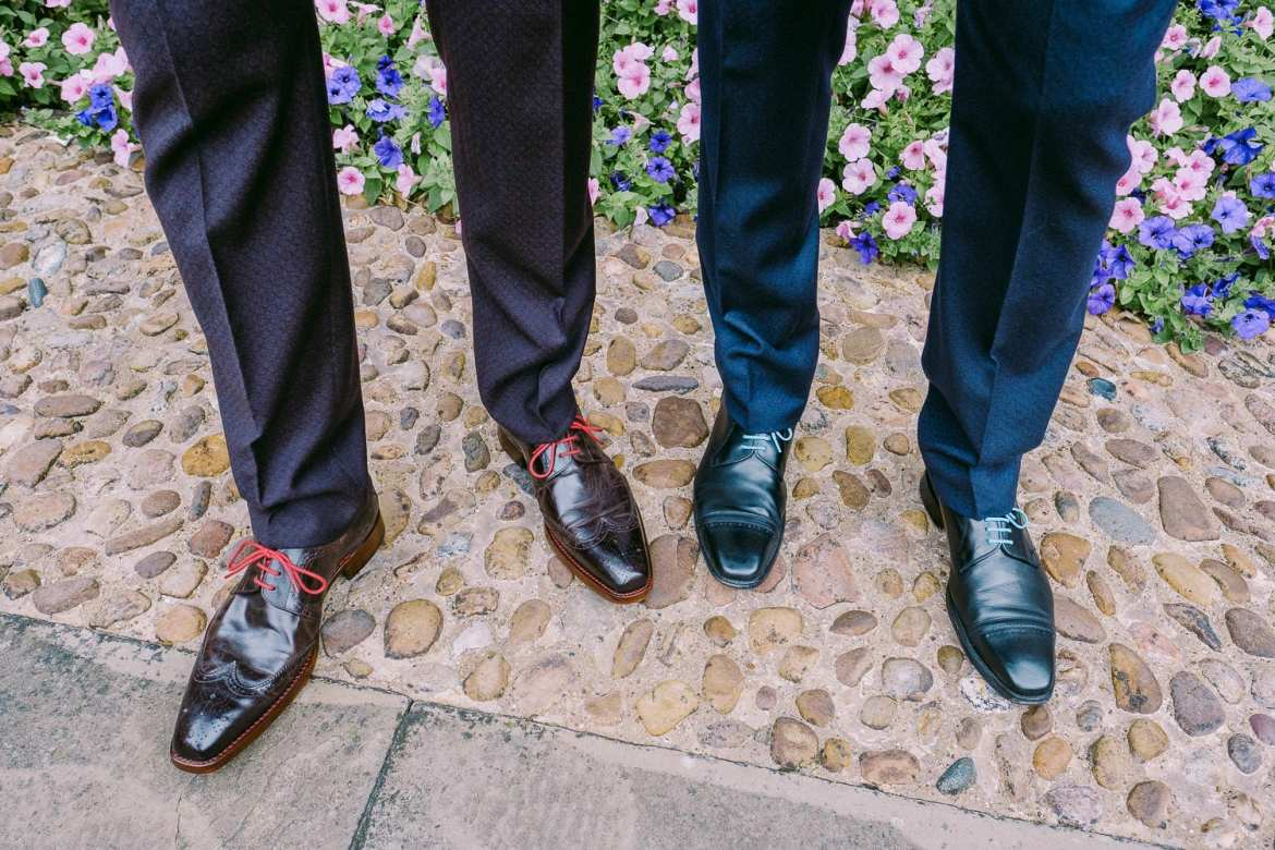 A detail of the grooms' shoes showing their coloured laces