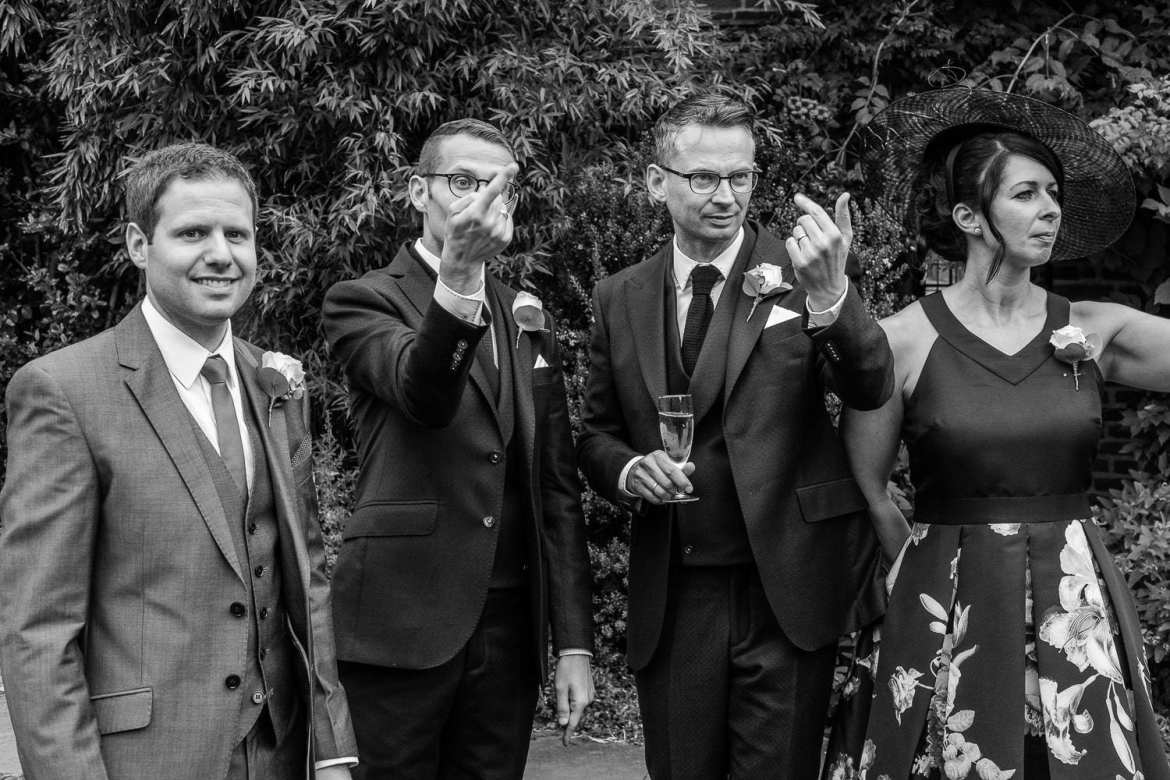 Wedding guests are beckoned for the formal portraits