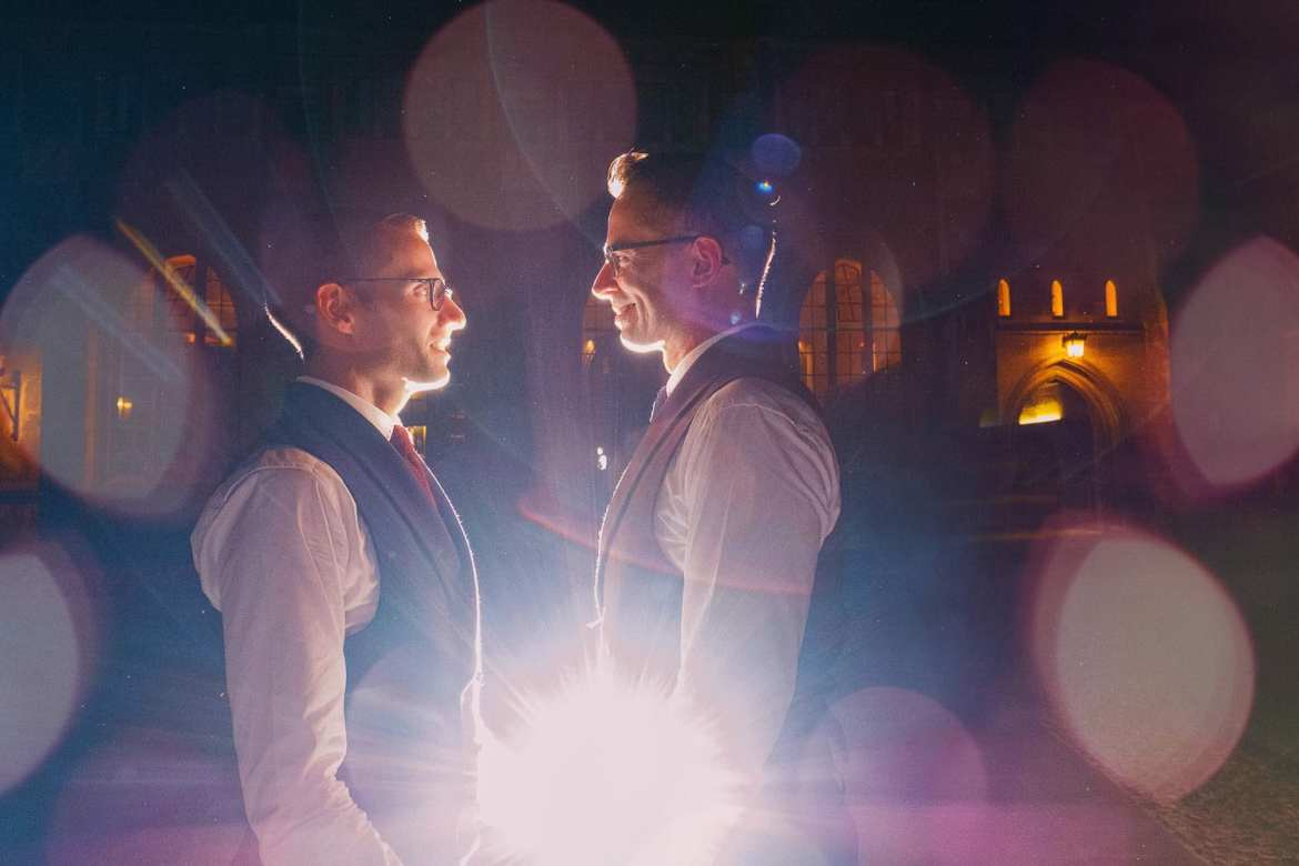 A spectacular portrait of two grooms at a gay wedding